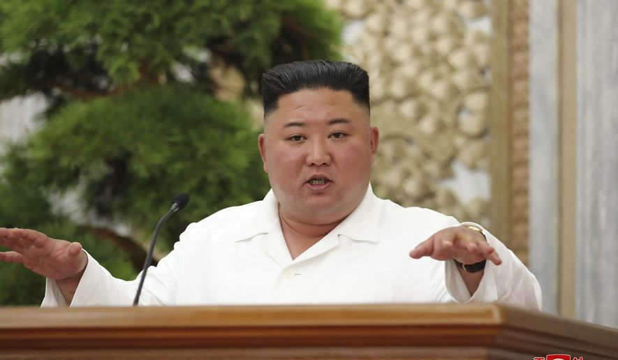 """In this photo provided by the North Korean government, North Korean leader Kim Jong Un attends a politburo meeting of the Central Committee of the Workers' Party of Korea in Pyongyang, North Korea Thursday, June 2, 2020. Independent journalists were not given access to cover the event depicted in this image distributed by the North Korean government. The content of this image is as provided and cannot be independently verified. Korean language watermark on image as provided by source reads: """"KCNA"""" which is the abbreviation for Korean Central News Agency. (Korean Central News Agency/Korea News Service via AP)"""