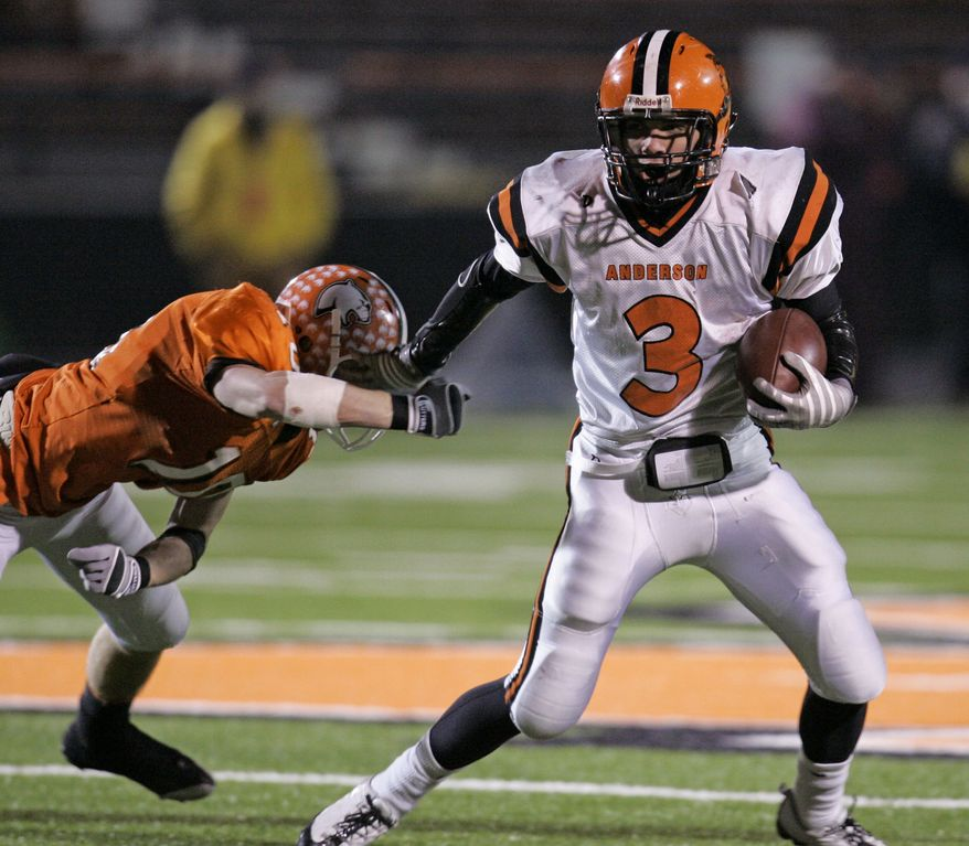 Cincinnati Anderson Redskins running back Kyle Slater (3) pushes Sylvania Southview Cougers defensive back Thomas Stichter (10) off and runs for a touchdown in the second quarter in a Division II high school state football championship game, Friday, Nov. 28, 2008, in Massillon, Ohio. (AP Photo/Tony Dejak)  **FILE**