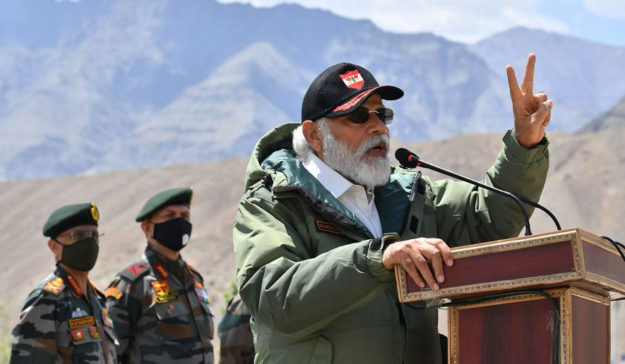 In this handout photo provided by the Press Information Bureau, Indian Prime Minister Narendra Modi addresses soldiers during a visit to Nimu, Ladakh area, India, Friday, July 3, 2020. Modi made an unannounced visit Friday to a military base in remote Ladakh region bordering China where the soldiers of the two countries have been facing off for nearly two months. (Press Information Bureau via AP)