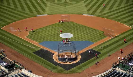 """A heart is visible in center field with the letters """"DC"""" as the Washington Nationals hold their first baseball training camp work out at Nationals Stadium, Friday, July 3, 2020, in Washington. (AP Photo/Andrew Harnik)"""