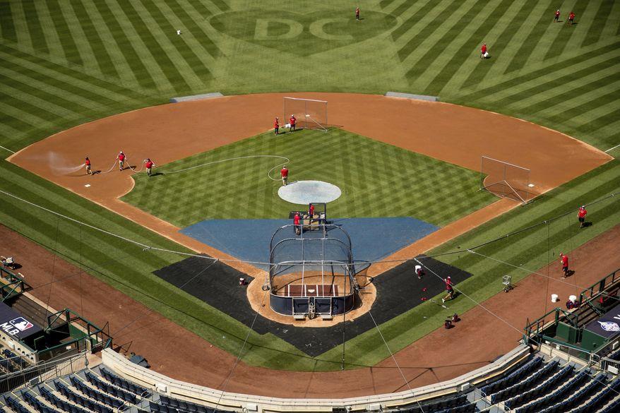 "A heart is visible in center field with the letters ""DC"" as the Washington Nationals hold their first baseball training camp work out at Nationals Stadium, Friday, July 3, 2020, in Washington. (AP Photo/Andrew Harnik)"