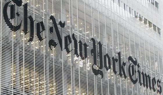 This Wednesday, Oct. 10, 2012, file photo shows The New York Times logo on the company's building in New York. (AP Photo/Richard Drew) ** FILE **