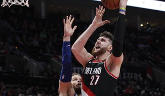 FILE - In this March 23, 2019, file photo, Portland Trail Blazers center Jusuf Nurkic, right, shoots as Detroit Pistons forward Blake Griffin defends during the second half of an NBA basketball game in Portland, Ore. Jusuf Nurkic is back and healthy. So are Zach Collins, Meyers Leonard, Giannis Antetokounmpo, Anthony Davis and plenty of others. If the four-month NBA shutdown had a silver lining, it's that a lot of ailing players got well.  (AP Photo/Steve Dipaola, File)