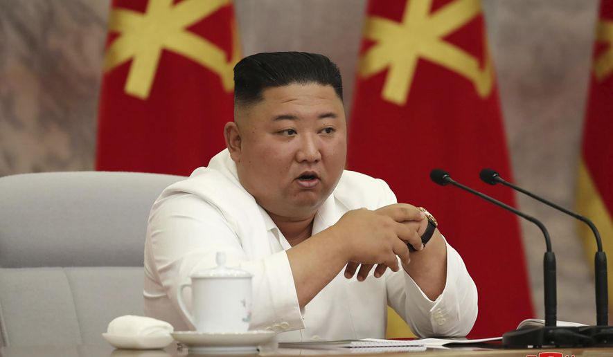 """In this photo provided by the North Korean government, North Korean leader Kim Jong-un attends a Politburo meeting of the Central Committee of the Workers' Party of Korea in Pyongyang, North Korea Thursday, June 2, 2020. Independent journalists were not given access to cover the event depicted in this image distributed by the North Korean government. The content of this image is as provided and cannot be independently verified. Korean language watermark on image as provided by source reads: """"KCNA"""" which is the abbreviation for Korean Central News Agency. (Korean Central News Agency/Korea News Service via AP)"""