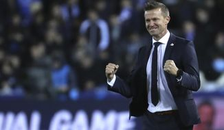 """FILE - In this file photo dated Wednesday, Nov. 27, 2019, Salzburg soccer coach Jesse Marsch stands on the sidelines during a Champions League group E soccer match against Genk at the KRC Genk Arena in Genk, Belgium. Marsch led Salzburg to this season's Austrian league title, the most significant trophy won by an American coach in Europe, and says he wanted """"to see if my idea of leadership could thrive in this competitive setting,"""" the Wisconsin native told The Associated Press Friday July 3, 2020. (AP Photo/Francisco Seco, FILE)"""