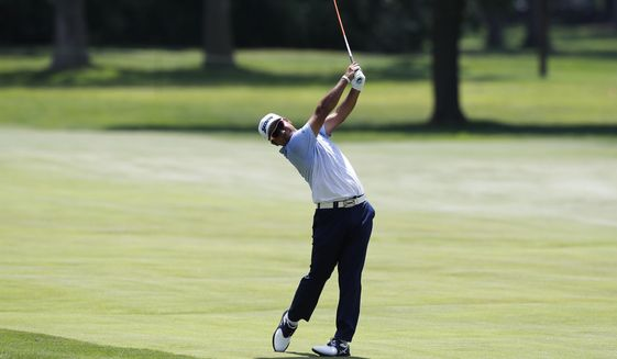 Hideki Matsuyama of Japan hits on the 17th fairway during the third round of the Rocket Mortgage Classic golf tournament, Saturday, July 4, 2020, at the Detroit Golf Club in Detroit. (AP Photo/Carlos Osorio)