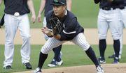 New York Yankees' Masahiro Tanaka, of Japan, runs drills with teammates during  spring training baseball workout Thursday, Feb. 13, 2020, in Tampa, Fla. (AP Photo/Frank Franklin II)