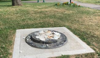 This photo provided by WROC-TV shows the remnants of a Frederick Douglass statue ripped from its base at a park in Rochester, N.Y., Sunday, July 5, 2020. The statue of abolitionist Douglass was ripped on the anniversary of one of his most famous speeches, delivered in that city in 1852. (Ben Densieski/WROC-TV via AP)