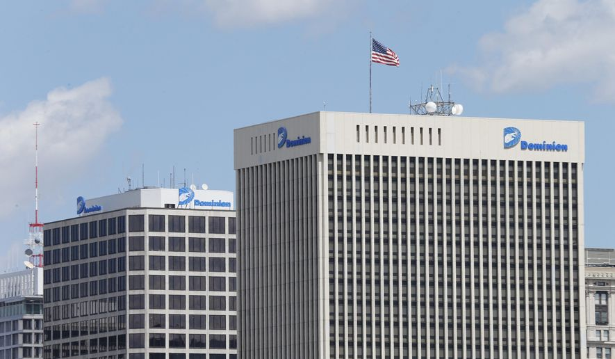 FILE - This April 28, 2015, file photo shows two Dominion Energy buildings in downtown Richmond, Va. The developers of the Atlantic Coast Pipeline announced Sunday, July 5, 2020, that they are canceling the multi-state natural gas project, citing delays and increasing cost uncertainty. (AP Photo/Steve Helber, File)