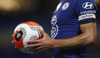 Chelsea's Cesar Azpilicueta holds the ball during the English Premier League soccer match between Chelsea and Watford at the Stamford Bridge stadium in London, Saturday, July 4, 2020. (Matthew Childs/Pool via AP)