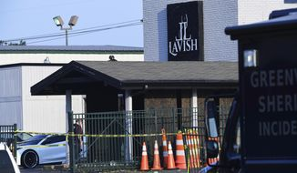 CORRECTS THE SOURCE TO KEN RUINARD WITH THE GREENVILLE NEWS - Yellow police tape can be seen outside of the Lavish Lounge in Greenville, S.C., Sunday, July 5, 2020, following a deadly shooting. (Ken Ruinard/The Greenville News via AP)