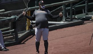 San Francisco Giants' Pablo Sandoval stands on the field during a baseball practice in San Francisco, Sunday, July 5, 2020. (AP Photo/Jeff Chiu)