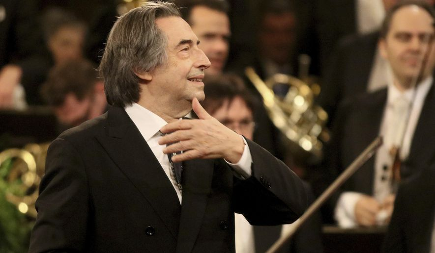 FILE - In this Jan. 1, 2018 file photo, Italian Maestro Riccardo Muti conducts the Vienna Philharmonic Orchestra during the traditional New Year's concert at the golden hall of Vienna's Musikverein, Austria. Nine musicians from the Syrian diaspora in Europe are playing in the 24th friendship concert conducted by Riccardo Muti, this year at the Paestum archaeological site in southern Italy, but the coronavirus pandemic blocked others from arriving directly from Syria. (AP Photo/Ronald Zak, File)