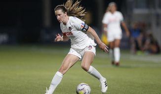 Washington Spirit midfielder Andi Sullivan brings the ball up the field during the second half of an NWSL Challenge Cup soccer match against the Portland Thorns at Zions Bank Stadium on Sunday, July 5, 2020, in Herriman, Utah. (AP Photo/Rick Bowmer) ** FILE **