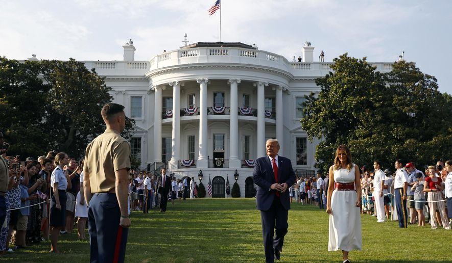 """President Donald Trump and first lady Melania Trump walk on the South Lawn of the White House during a """"Salute to America"""" event, Saturday, July 4, 2020, in Washington. (AP Photo/Patrick Semansky)"""