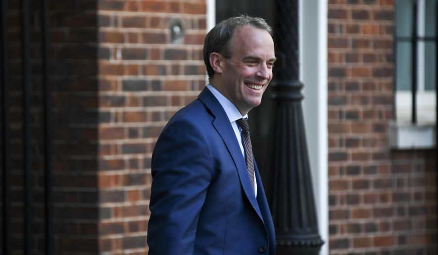 FILE - In this file photo dated Thursday, May 7, 2020, Britain's Foreign Secretary Dominic Raab arrives at 10 Downing Street, in London. Raab on Monday July 6, 2020, announced targeted economic sanctions against individuals and organizations from Russia, Saudi Arabia, Myanmar and North Korea under new U.K. powers to punish human-rights offenders.(AP Photo/Alberto Pezzali, FILE)