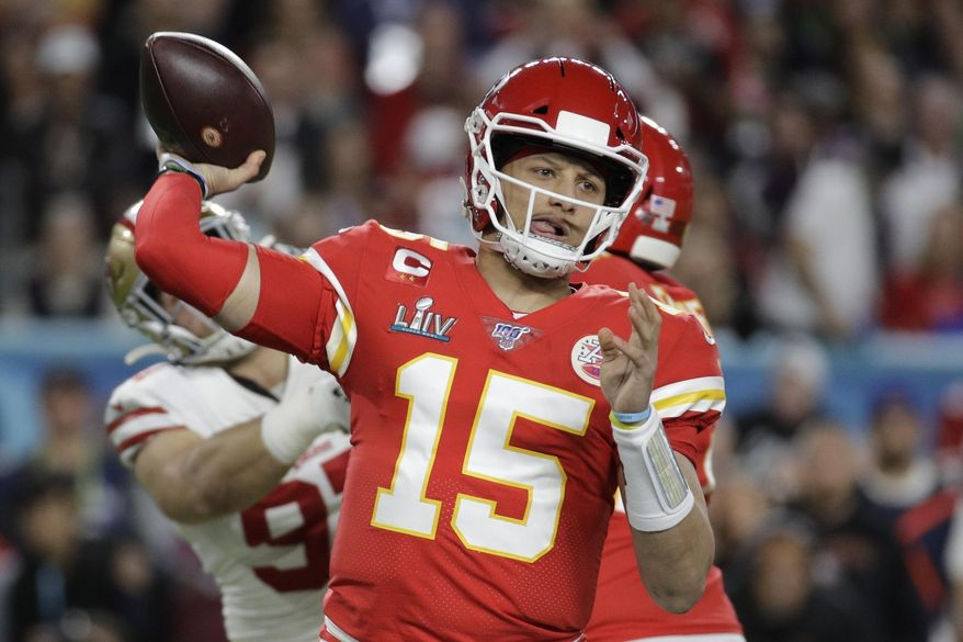 In this Feb. 2, 2020, file photo, Kansas City Chiefs quarterback Patrick Mahomes (15) passes against the San Francisco 49ers during the first half of the NFL Super Bowl 54 football game in Miami Gardens, Fla. The Chiefs have agreed to a 10-year contract extension with Super Bowl MVP Mahomes keeping him around through 2031. The Chiefs had Mahomes under contract for the next two seasons but wanted a long-term deal in place with the quarterback who led them to their first championship in 50 years.  ESPN.com reported the deal is worth $450 million with an injury guarantee of $140 million. (AP Photo/Patrick Semansky) ** FILE **