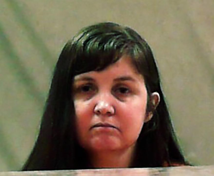 FILE - This undated file photo provided by the West Virginia Division of Corrections and Rehabilitation shows Elizabeth Jo Shirley. The West Virginia woman who previously served in the Air Force planned to offer top-secret information from the National Security Agency to the Russian government, prosecutors said Monday, July 6, 2020, in announcing her conviction in federal court. Shirley pleaded guilty as part of a plea agreement. (West Virginia Division of Corrections and Rehabilitation via AP, File)
