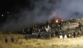 In this Nov. 20, 2016, file photo, provided by Morton County Sheriff's Department, law enforcement and protesters clash near the site of the Dakota Access pipeline on Sunday, Nov. 20, 2016, in Cannon Ball, N.D. A federal judge on Monday, July 6, 2020, sided with the Standing Rock Sioux Tribe and ordered the Dakota Access pipeline to shut down until more environmental review is done. (Morton County Sheriff's Department via AP, File)