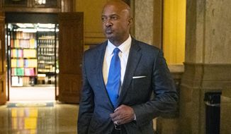 FILE - In this Oct. 23, 2019, file photo, Indiana Attorney General Curtis Hill arrives for a hearing at the state Supreme Court at the Statehouse in Indianapolis. Indiana's Republican delegates are continuing to cast their ballots as the time nears to select who will run for state attorney general in November 2020. The spotlight is expected to be on incumbent Hill, who must convince delegates that he deserves a second term despite his misconduct allegations. (AP Photo/Michael Conroy, File)