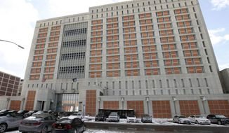 FILE- This Jan. 8, 2017 file photo shows the Metropolitan Detention Center (MDC) in the Brooklyn borough of New York. The Bureau of Prisons confirmed Ghislaine Maxwell, longtime confidante of Jeffrey Epstein, was transferred to the facility Monday, July 6, 2020, after being arrested the preceding Thursday in New Hampshire. She faces charges she helped Epstein recruit women to sexually abuse. (AP Photo/Kathy Willens, File)