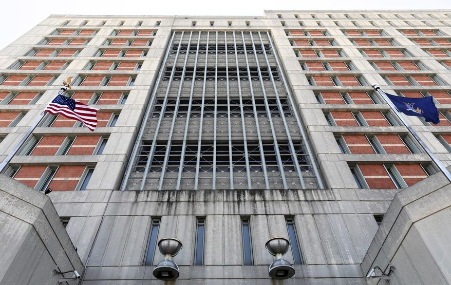 Flags fly in front of the Metropolitan Detention Center, Monday, July 6, 2020, in the Brooklyn borough of New York. Jeffrey Epstein's longtime confidante Ghislaine Maxwell has been transferred to New York to face charges she recruited women and girls for him to sexually abuse. The Bureau of Prisons confirmed that Maxwell was transferred Monday and is currently being held at the MDC. (AP Photo/Mark Lennihan)