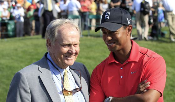 FILE - In this June 3, 2012, file photo, Jack Nicklaus, left, talks with Tiger Woods after Woods won the Memorial golf tournament at the Muirfield Village Golf Club in Dublin, Ohio. The PGA Tour has a deal that would bring a one-time event to Muirfield Village a week before the Memorial, giving it tournaments in consecutive weeks.  (AP Photo/Tony Dejak, File)  **FILE**