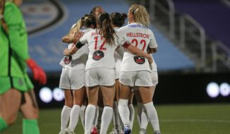 Washington Spirit players celebrate with Sam Staab after she scored a goal against the Portland Thorns during the second half of an NWSL Challenge Cup soccer match at Zions Bank Stadium on Sunday, July 5, 2020, in Herriman, Utah. (AP Photo/Rick Bowmer)