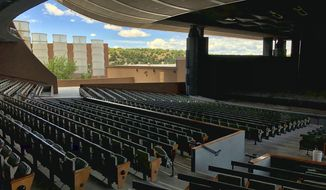 FILE - In this May 8, 2019, file photo, the Santa Fe Opera awaits its summer season in Santa Fe, N.M. The Santa Fe Opera, Meow Wolf and the non-profit organization that puts on the Albuquerque International Balloon Fiesta are among the New Mexico businesses that received loans from the federal government as part of massive effort to support the economy amid the coronavirus outbreak. (AP Photo/Morgan Lee, File)