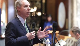 FILE - In this April 14, 2020 file photo, Wisconsin Assembly Speaker Robin Vos speaks at the state Capitol in Madison Wis. A company Speaker Vos runs received between $150,000 and $350,000 through the federal government's coronavirus small business lending program. That's according to lists of recipients the U.S. Treasury Department released Monday, July 6, 2020. That data shows Robin J. Vos Enterprises in Burlington received the money through the Paycheck Protection Program. The company manufactures popcorn and popcorn supplies. (Rick Wood/Milwaukee Journal-Sentinel via AP, File)