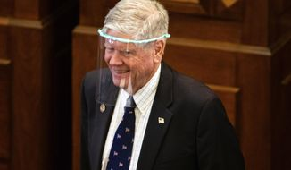 FILE - In this May 21, 2020, file photo, state Sen. Jim Oberweis, R-Sugar Grove, wears a full face shield while on the floor of the Illinois Senate during session at the State Capitol in Springfield, Ill. Oberweis is the GOP nominee for a Chicago-area congressional seat and the chairman of Oberweis Dairy. The dairy received a Paycheck Protection Program loan of between $5 million and $10 million, according to data released by the Treasury Department. Oberweis, who also owns an investment firm, has loaned his congressional campaign against Democrat Rep. Lauren Underwood more than $1.1 million since last year. (Justin L. Fowler/The State Journal-Register via AP, Pool, File)