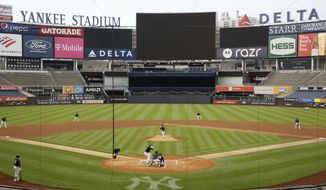 New York Yankees starting pitcher J.A. Happ throws to Miguel Andujar during the first inning of an intrasquad baseball game Monday, July 6, 2020, at Yankee Stadium in New York. (AP Photo/Kathy Willens)