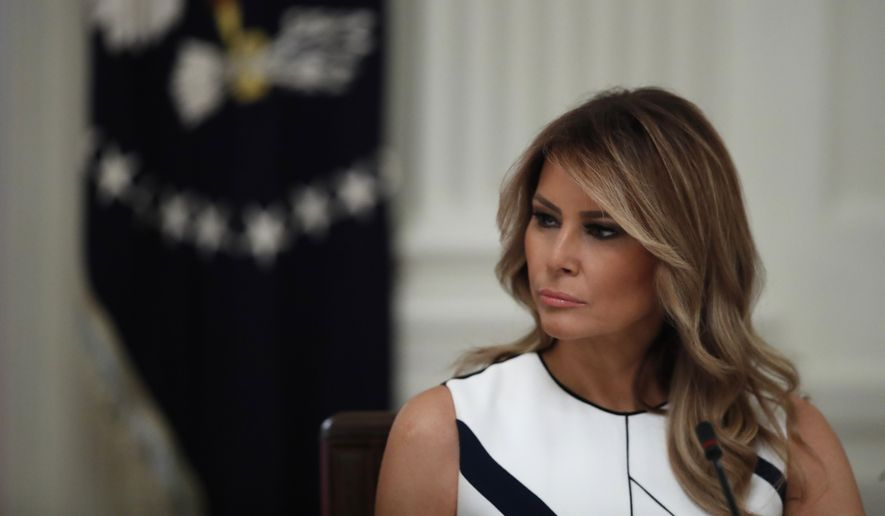 """First lady Melania Trump listens as President Donald Trump speaks during a """"National Dialogue on Safely Reopening America's Schools,"""" event in the East Room of the White House, Tuesday, July 7, 2020, in Washington. (AP Photo/Alex Brandon)"""