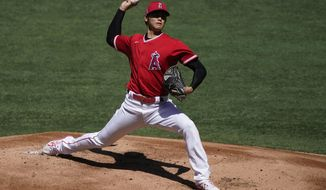 Los Angeles Angels starting pitcher Shohei Ohtani pitches during an intrasquad game at baseball practice at Angel Stadium on Tuesday, July 7, 2020, in Anaheim, Calif. (AP Photo/Ashley Landis)