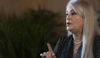 FILE - In this Aug. 16, 2019 file photo, Puerto Rico Gov. Wanda Vazquez speaks during an interview with the Associated Press at the official residence La Fortaleza, in San Juan, Puerto Rico. Vazquez announced on Saturday, May 16, 2020, that she will hold a non-binding referendum in November to decide whether Puerto Rico should become a U.S. state. (AP Photo/Dennis M. Rivera Pichardo, File)