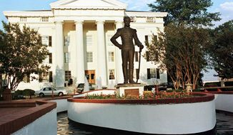 FILE - This June 10, 1999, file photograph shows the bronze statue of Andrew Jackson in front of Jackson, Miss., City Hall. The City Council voted 5-1, Tuesday, July 7, 2020, to relocate the bronze figure in a less prominent spot. It's the latest of many changes in the United States as people reconsider monuments to historical figures with connections to slavery and racism. Jackson, the nation's seventh president, owned enslaved people and oversaw the forced migration of Native Americans in which many died. (AP Photo/Rogelio V. Solis, File)