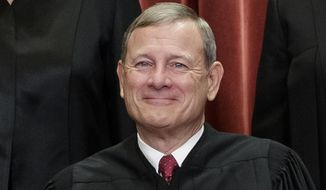 This Nov. 30, 2018, photo shows Supreme Court Chief Justice John Roberts as he sits with fellow justices for a group portrait at the Supreme Court Building in Washington. (AP Photo/J. Scott Applewhite) **FILE**