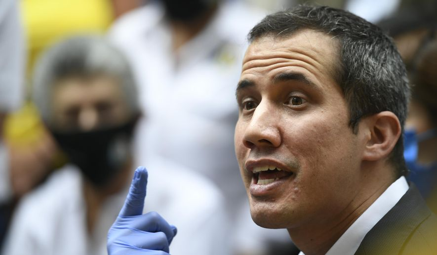 Venezuelan opposition leader Juan Guaido speaks upon his arrival to the headquarters of Democratic Action political party in Caracas, Venezuela, Wednesday, June 17, 2020, the day after Venezuela's Supreme Court ordered its takeover ahead of parliamentary elections expected this year. (AP Photo/Matias Delacroix) **FILE**