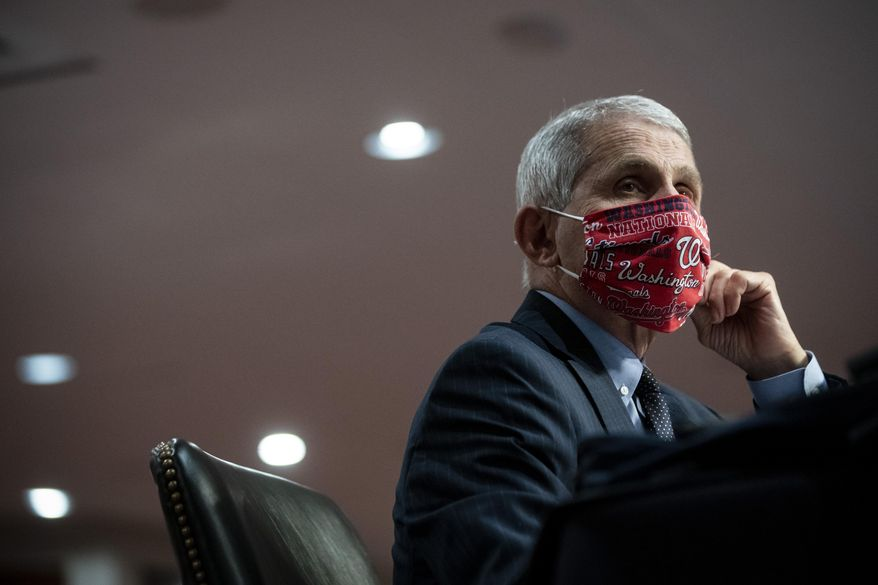 Director of the National Institute of Allergy and Infectious Diseases Dr. Anthony Fauci wears a face covering as he listens during a Senate Health, Education, Labor and Pensions Committee hearing on Capitol Hill in Washington, Tuesday, June 30, 2020. (Al Drago/Pool via AP) ** FILE **