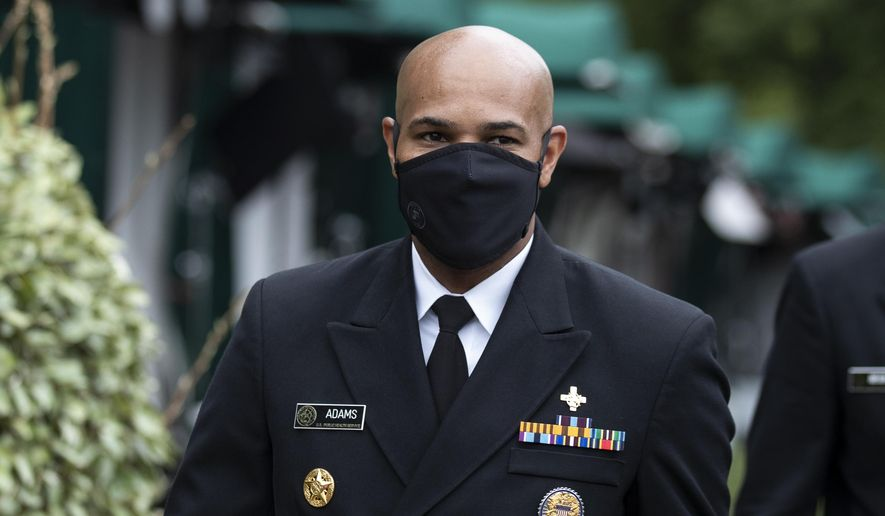 U.S. Surgeon General Jerome Adams departs after a television interview on the North Lawn of the White House, Tuesday, July 7, 2020, in Washington. (AP Photo/Alex Brandon)