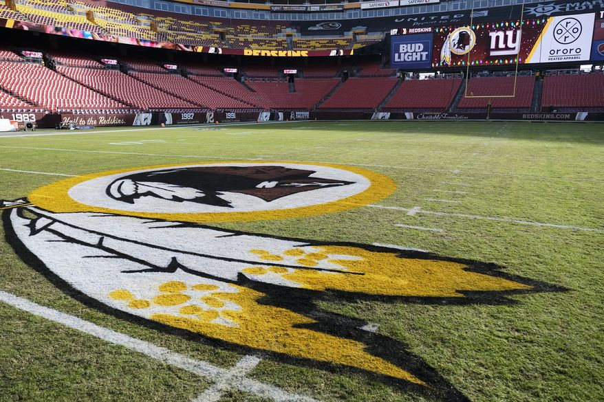In this Dec. 22, 2019, file photo, the Washington Redskins logo is seen on FedEx Field prior to an NFL football game between the New York Giants and the Redskins in Landover, Md. Washington state Attorney General Bob Ferguson says Seattle-based Amazon will begin pulling Redskins team merchandise from its online marketplace. Ferguson urged the online giant to remove such merchandise it because of growing calls for the team to change what he called their use of a racial slur in the name. (AP Photo/Mark Tenally) ** FILE **