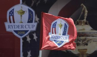 This Sept. 26, 2016, file photo shows a flag blowing in the wind before the Ryder Cup golf tournament at Hazeltine National Golf Club in Chaska, Minn. The Ryder Cup was postponed until 2021 in Wisconsin because of the COVID-19 pandemic that raised too much uncertainty whether the loudest event in golf could be played before spectators. The announcement Wednesday, July 8, 2020, was inevitable and had been in the works for weeks as the PGA of America, the European Tour and the PGA Tour tried to adjust with so many moving parts.(AP Photo/Charlie Riedel, File)  **FILE**