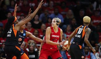 In this Oct. 10, 2019, file photo, Connecticut Sun forward Jonquel Jones, left, and guard Courtney Williams, right, huard Washington Mystics forward Elena Delle Donne during the first half of Game 5 of basketball's WNBA Finals in Washington. Delle Donne is waiting to have her case heard by the league's independent panel of doctors to see if she'll be medically excused for the season, according to the Mystics. The Mystics star, who was the league Most Valuable Player last year, has battled Lyme Disease since 2008 and would potentially be at a higher risk for serious illness if she contracted the new coronavirus. (AP Photo/Alex Brandon, File)  **FILE**