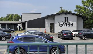 The Lavish Night Club where a shooting early Sunday night left numerous dead and at least 8 injured Sunday, July 5, 2020, in Greenville, S.C. (AP Photo/Richard Shiro)