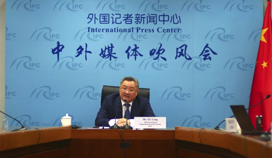 Fu Cong, director general of the Depatment of Arms Control of the Chinese Ministry of Foreign Affairs, speaks to media at a press briefing on nuclear arms talks in Beijing on Wednesday, July 8, 2020. The senior Chinese arms control official called U.S. pressure to join nuclear arms talks with Russia a ploy to walk away from them, and said China would gladly participate if the U.S. would agree to parity among all three. (AP Photo/Sam McNeil)