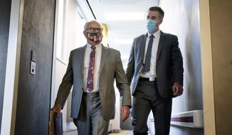 Former Minneapolis police officer Thomas Lane, right, walks out of the Hennepin County Public Safety Facility on Monday afternoon June 20, 2020, in Minneapolis with his attorney, Earl Gray, after a hearing. Lane is one of four former officers charged in the death of George Floyd. (Glen Stubbe/Star Tribune via AP)