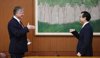 U.S. Deputy Secretary of State Stephen Biegun, left, is greeted by his South Korean counterpart Lee Do-hoon during their meeting at the Foreign Ministry in Seoul Wednesday, July 8, 2020. Biegun is in Seoul to hold talks with South Korean officials about allied cooperation on issues including North Korea. (Kim Hong-ji/Pool Photo via AP)
