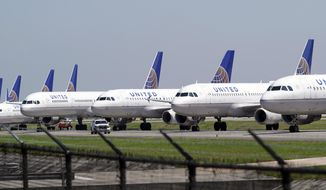 In this March 25, 2020, file photo, United Airlines planes are parked at George Bush Intercontinental Airport in Houston. (AP Photo/David J. Phillip, File)