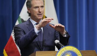 FILE - In this May 14, 2020, file photo, California Gov. Gavin Newsom discusses his revised 2020-2021 state budget during a news conference in Sacramento, Calif. President Donald Trump weighed in on Wednesday, July 8, 2020, threatening to withhold federal money from school districts if they don't open their doors for the new school year in the fall.  Newsom dismissed that threat, saying school districts will decide for themselves whether it is safe to open. But he said those decisions will be based on whether people can slow the spread of the virus by changing their behavior. (AP Photo/Rich Pedroncelli, Pool, File)
