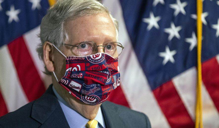 In this June 30, 2020, file photo Senate Majority Leader Mitch McConnell, R-Ky., listens to questions during a news conference following a GOP policy meeting on Capitol Hill in Washington. McConnell is emerging the GOP's mask spokesman, the highest-ranking Republican in Congress proselytizing about the importance of wearing a face-covering during the coronavirus pandemic. (AP Photo/Manuel Balce Ceneta, File)
